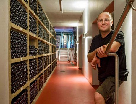 Winegrower Jochen Kreutzenberger, Kindenheim, Palatinate, in his realm: in front of the wine storage facility filled with fine wines from his vineyards. Photo: Kreuzenberger family